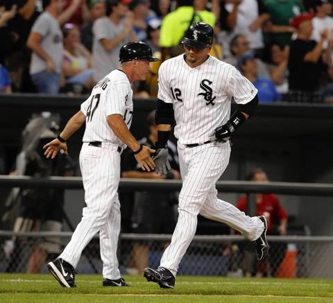 Third base coach Joe McEwing congratulates A.J. Pierzynski after his solo homer in the 5th.
