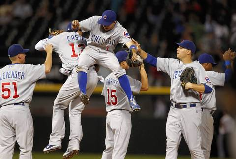 Tony Campana and Starlin Castro jump up in celebration of their team's 12-3 win over the White Sox.