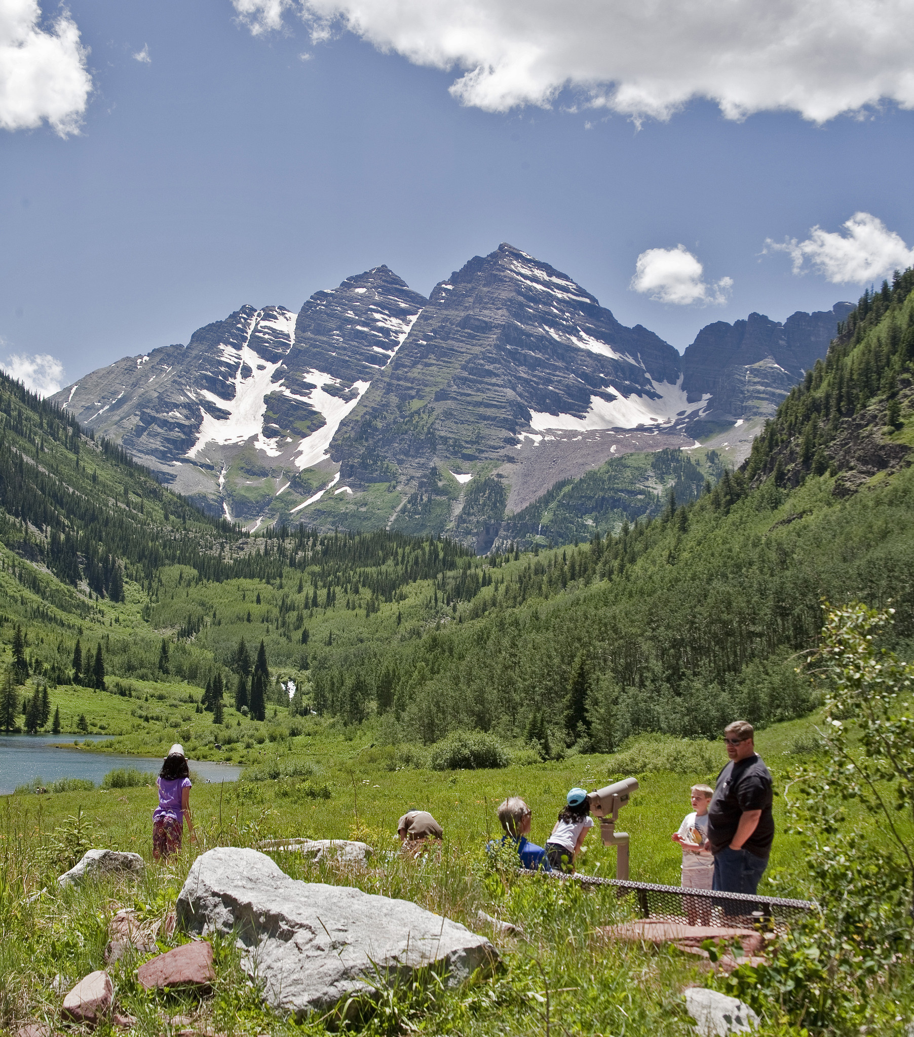 Nature trails follow Maroon Lake shores, in the White River N.F. Maroon Bells Peaks in the rear, Aspen, Colorado.