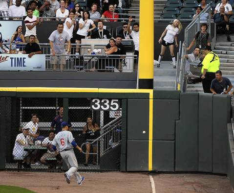 Cubs OF Bryan LaHair watches as Alexei Ramirez' double bounces into the stands, scoring Alex Rios in the 2nd inning.