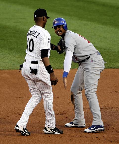 Alexei Ramirez tags out the Cubs' Starlin Castro during a steal attempt in the 1st inning.