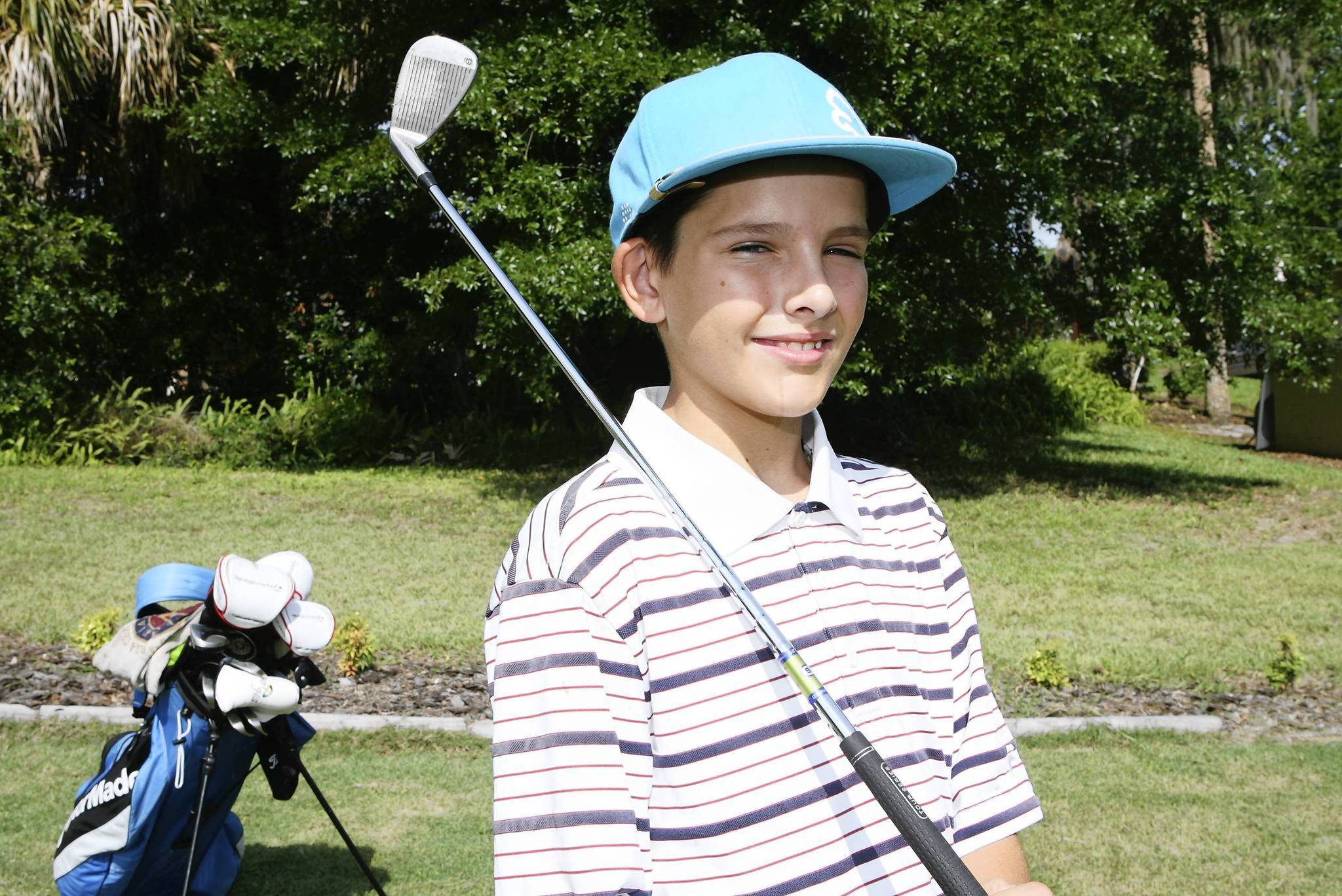 Justin Rickerson is pictured at his Eustis home on Tuesday, June 5, 2012. The 11 year old  shot a hole in one at the Mount Dora County Club. (Tom Benitez/Orlando Sentinel)