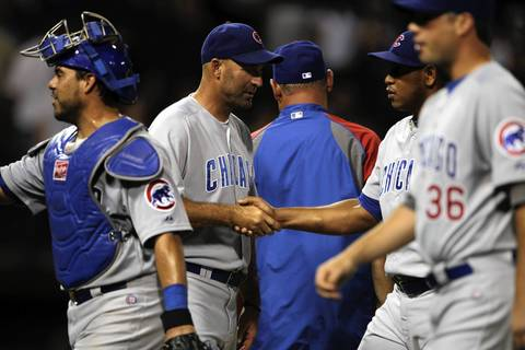 Cubs manager Dale Sveum shakes hands with Carlos Marmol following the 2-1 win.