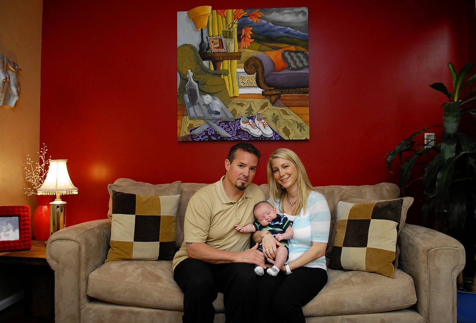 Jennifer Klein and her husband George Klein, Jr., with their infant son Luke, in the living room of their Perry Hall home.