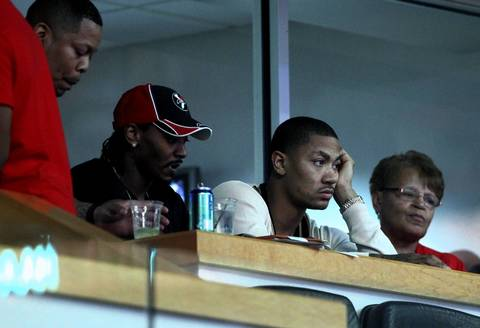 Injured Chicago Bulls point guard Derrick Rose watches the action from a suite during game 5 of the first round of NBA playoffs at the United Center.