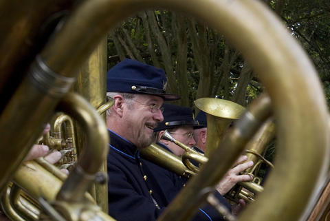 The Federal City Brass Band plays for visitors to Berkeley Plantation in Charles City on Friday to commemorate the 150th anniversary of Taps.
