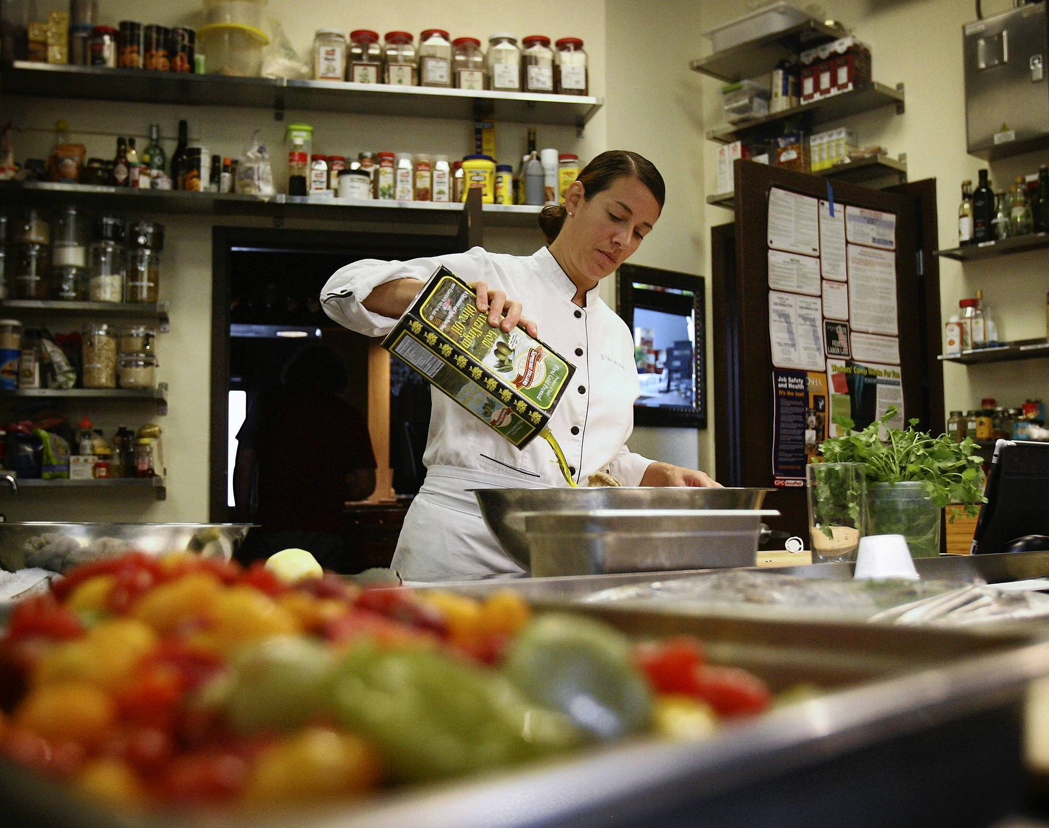 Loren Falsone, chef and owner of The Table in Orlando prepares a meal for a private party at the restaurant on Thursday,