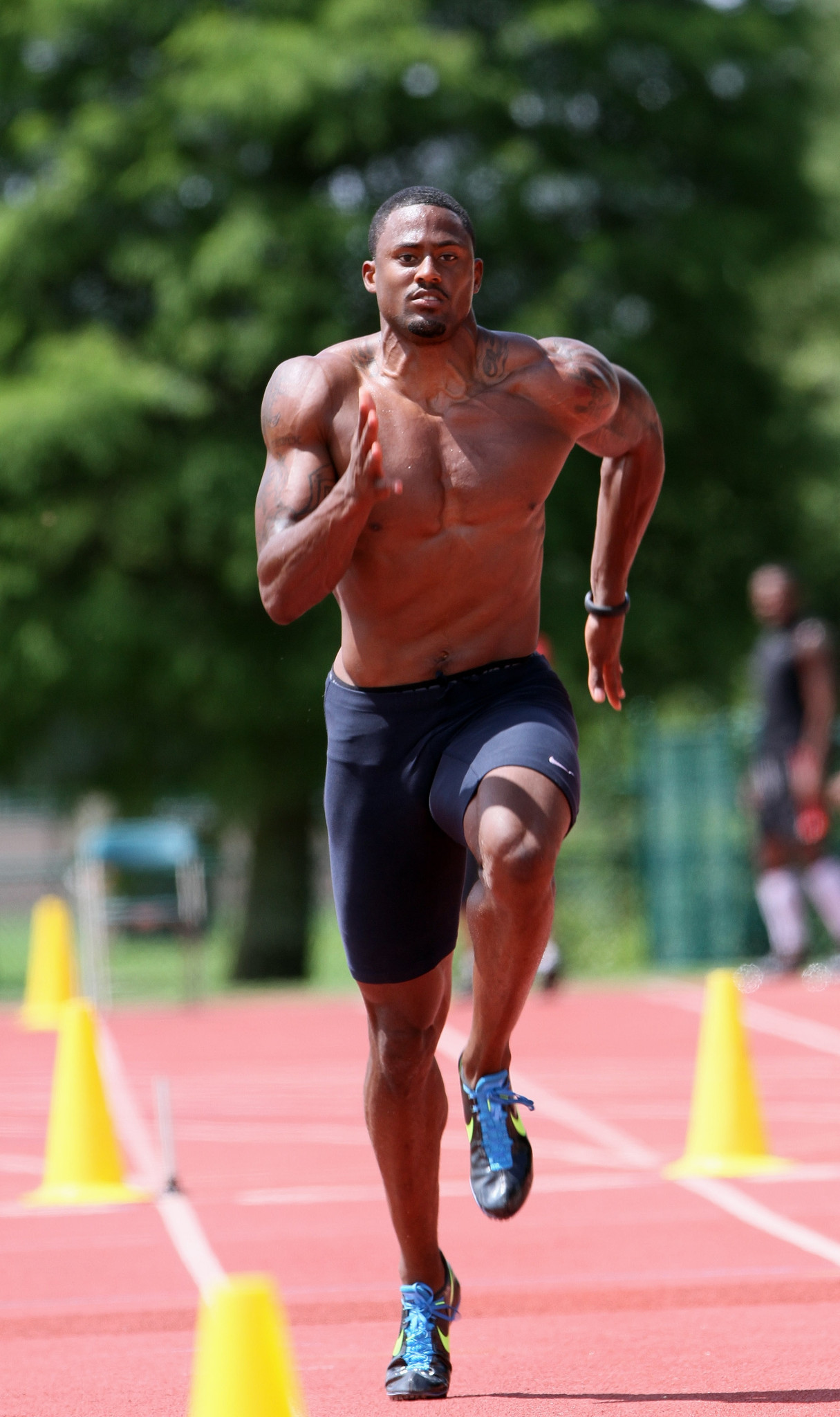 Olympic 110-meter hurdles bronze medalist David Oliver sprints while training with coach Brooks Johnson at ESPN Wide World of Sports at Walt Disney World, on Monday, June 11, 2012.