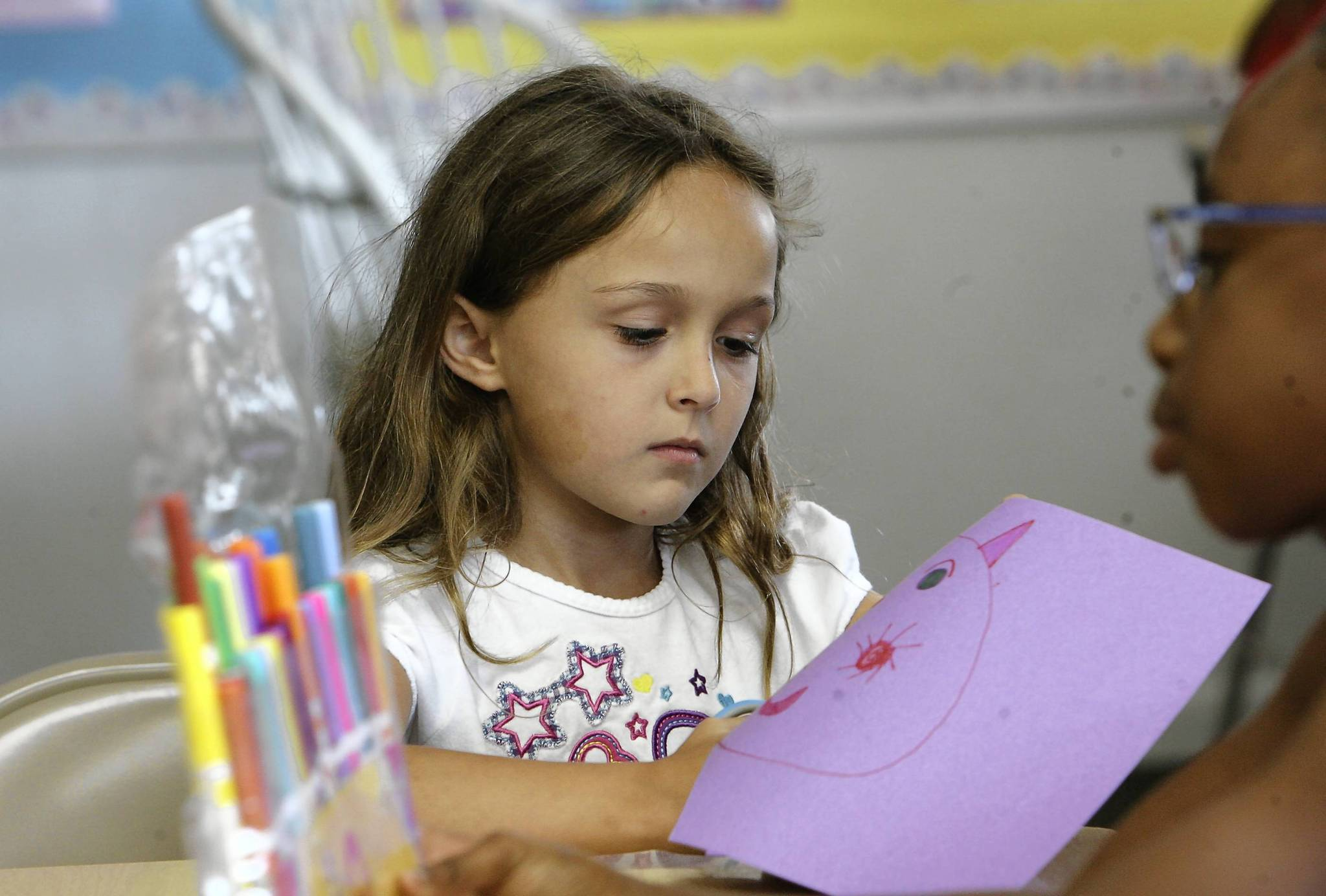 Allison Atherton, 7, creates in art class on Thursday, June 14, 2012. The new Boys and Girls Club in Lady Lake has launched it's first summer  program . The Boys & Girls recently opened its door at the First Baptist Church of Lady Lake on CR 466. (Tom Benitez/Orlando Sentinel