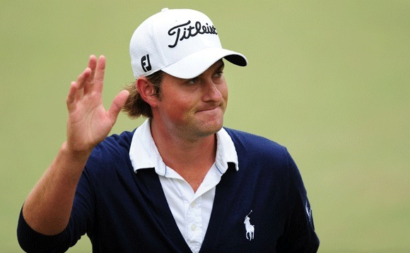 Webb Simpson acknowledges the crowd after finishing at the 18th hole en route to winning the 112th U.S. Open at San Francisco's Olympic Club on June 17.
