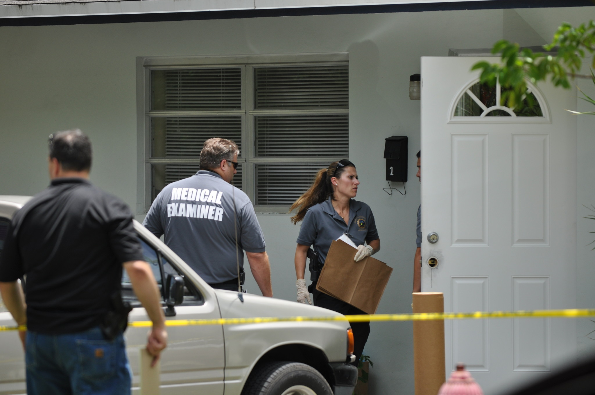 Investigators with the Fort Lauderdale Police and the Broward Medical Examiner's office work a suspicious death at the 1100 block of Southwest 16th Avenue.