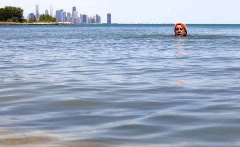 "Frank ""Mayor of the Rocks"" Rizzo, 71, takes a cooling swim at Promontory Point in Hyde Park."