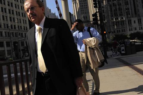 Businessmen walk south on Michigan Avenue as the temperatures climb.