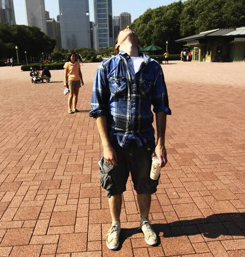 Tyler Demers of Boston cools off in the mist of the Buckingham Fountain.