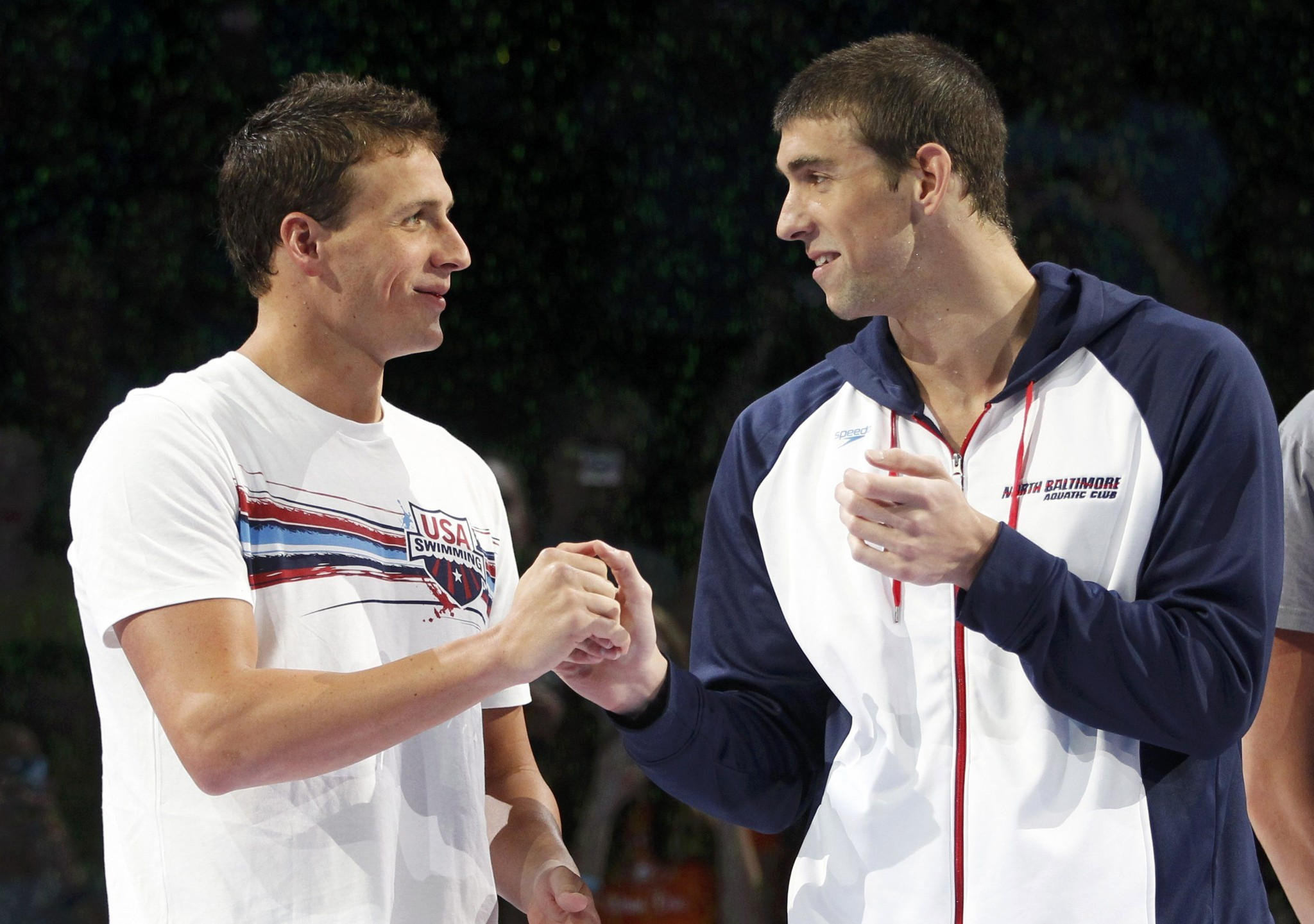 Ryan Lochte shakes hands with Michael Phelps before the medal ceremony for the men's 200 meter freestyle final during the U.S. Olympic swimming trials.