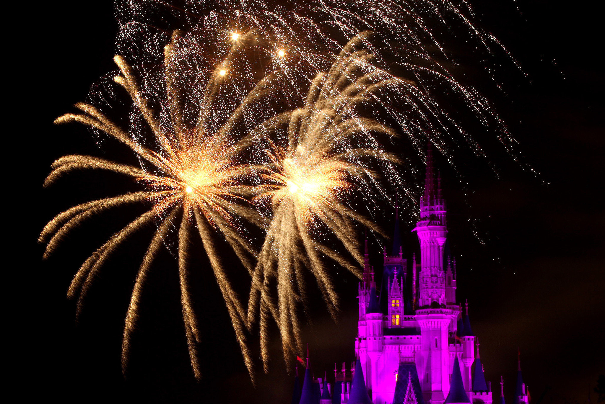 Fireworks explode over Cinderella Castle, at Walt Disney World's Magic Kingdom, during the 'Wishes' fireworks show.