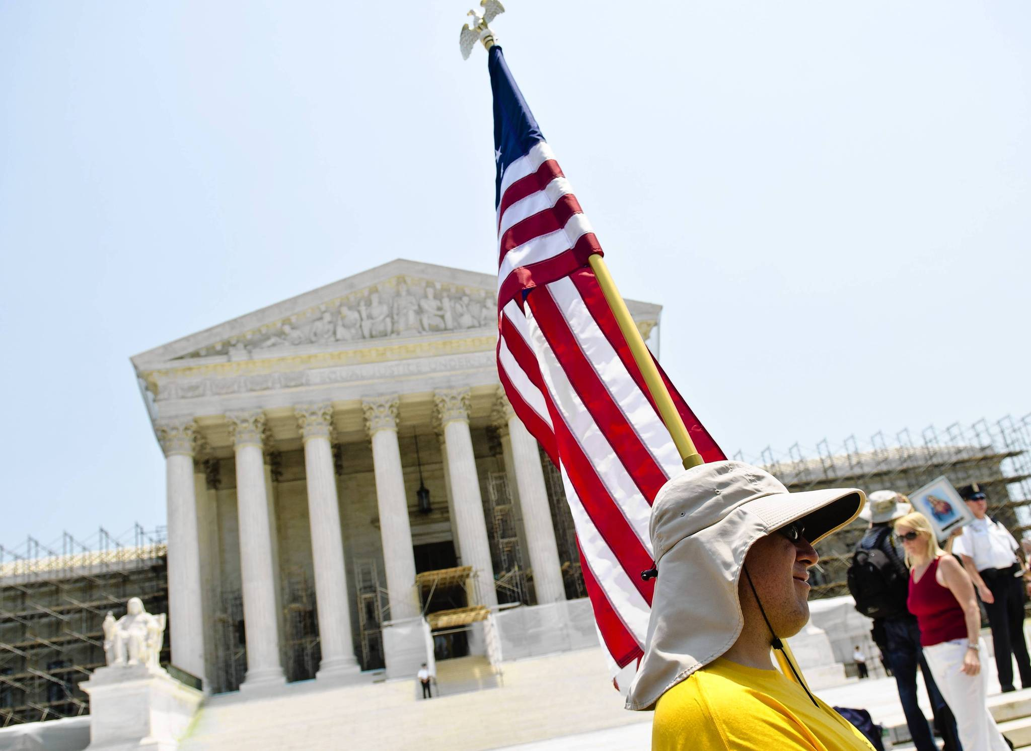 A protestor stands outside the U.S. Supreme Court on June 28, 2012 in Washington, DC. The Court found the Affordable Healthcare Act to be constitutional and did not strike down any part of it.