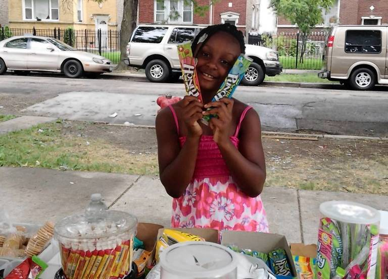 Heaven Sutton, 7, at the candy stand in front of her house earlier on the day she was shot.