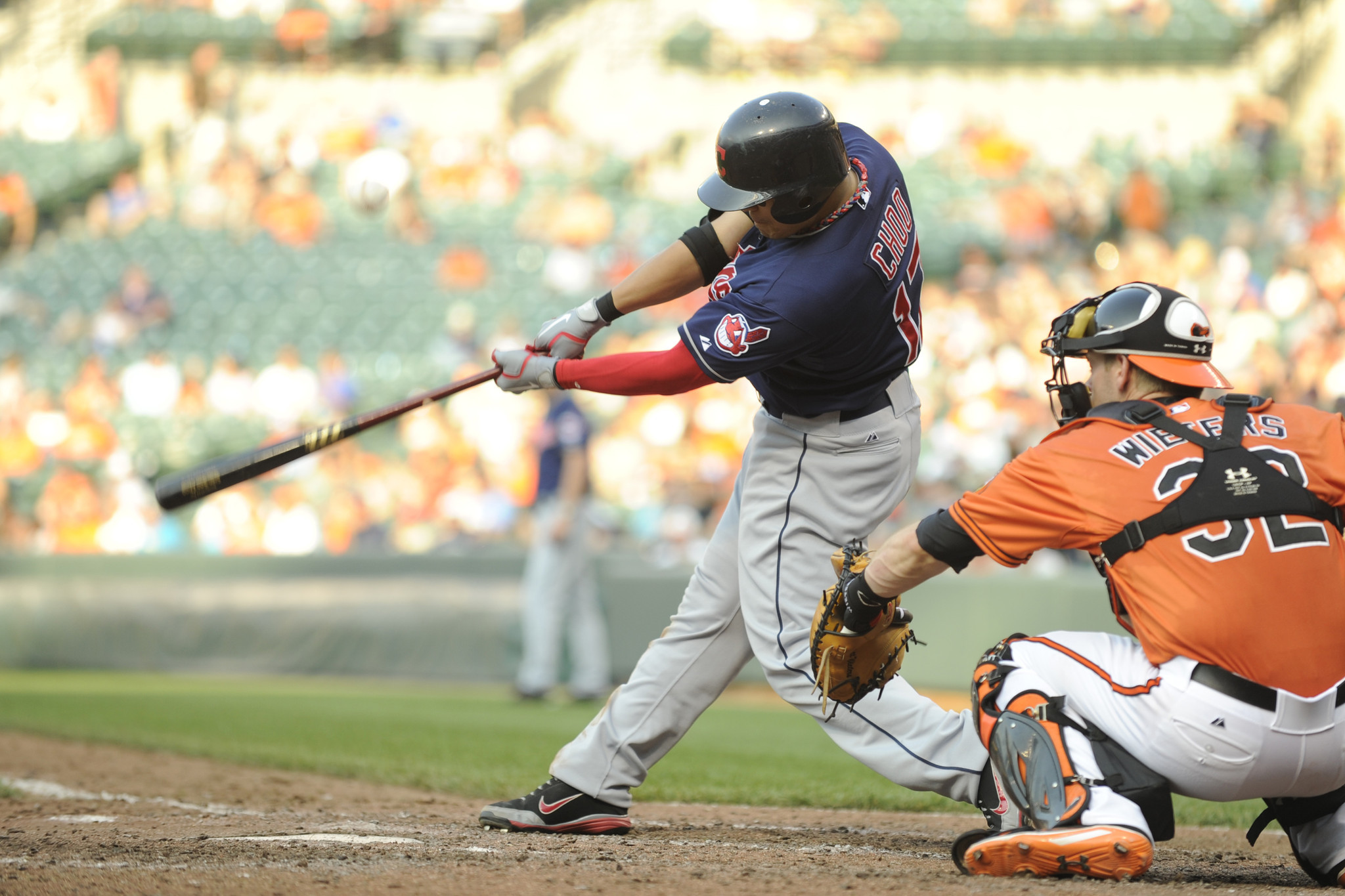 Cleveland Indians outfielder Shin-Soo Choo swings during the game at Camden Yards as Orioles catcher Matt Wieters awaits the pitch. Choo was 4-for-5 with four runs scored and three RBIs in the Indians' 11-5 victory.