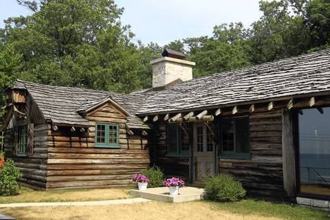 """The Cypress Log Cabin, one of five """"Century of Progress"""" homes, is located on Lake Front Drive in Beverly Shores, Ind. A free tour of the homes, which were built for the 1933 Chicago World's Fair, is offered by reservation only one day each October (Saturday, October 20, 2012), between 8:00 a.m. and 5:30 p.m."""