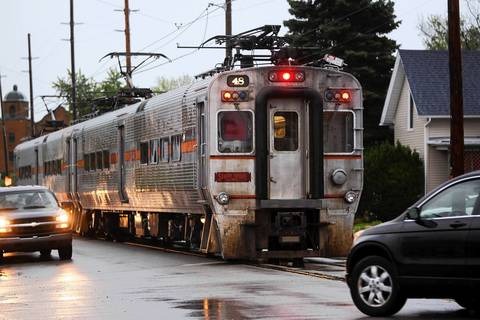 An eastbound South Shore Line train arrives at the 11th Street station in Michigan City, Ind., where the tracks are at street level. The train travels from Chicago's Millennium Station along the northern Indiana shoreline to the South Bend Airport.