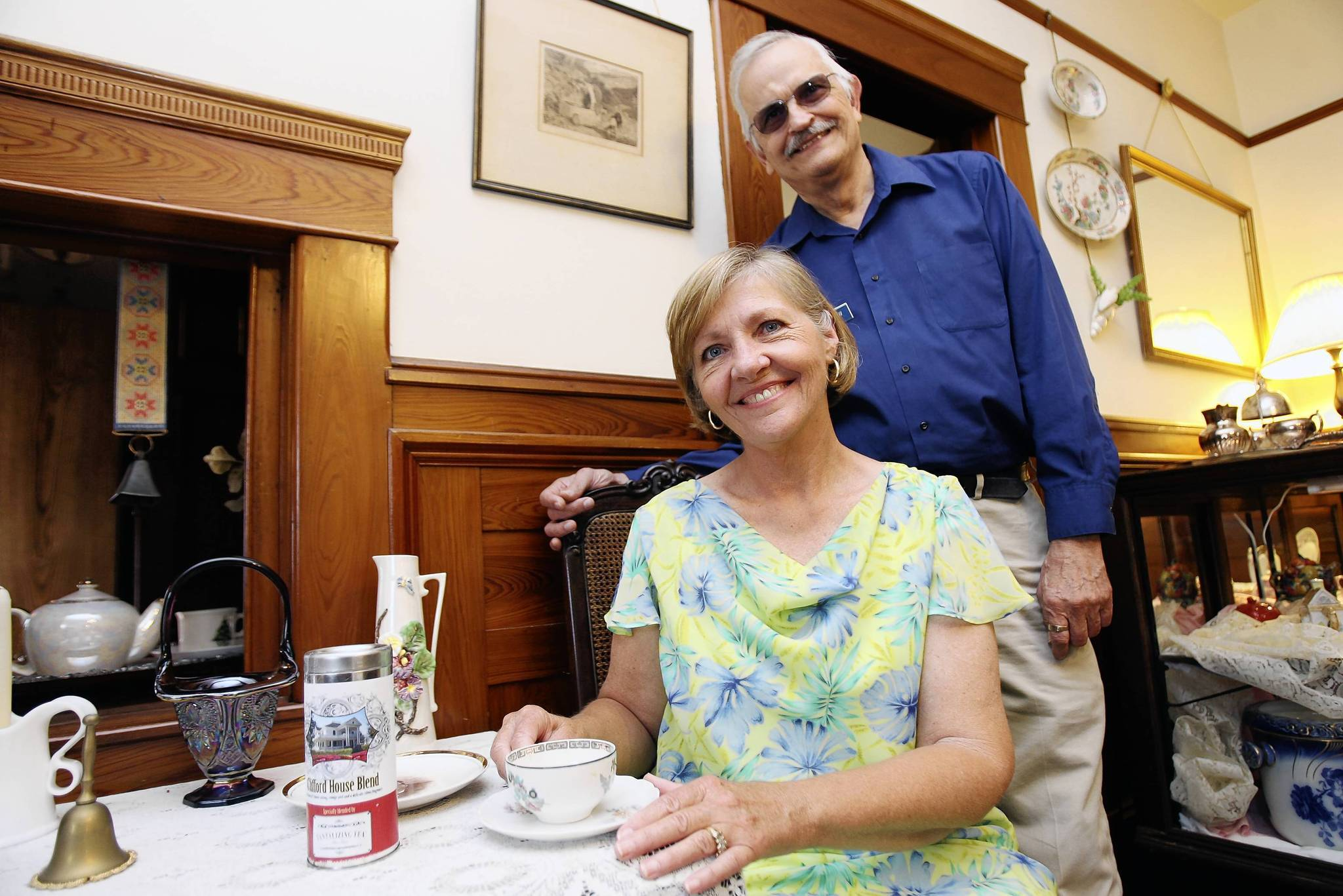 Ted Waterfall, curator of the Eustis Historical Museum, and Kathy Niles pose for a portrait on Thursday, June 21, 2012. Niles created Clifford House Blend . The tea is a intermingling of Chinese orange peel and delicate, tantalizing citrus fragrances.. (Tom Benitez/Orlando Sentinel