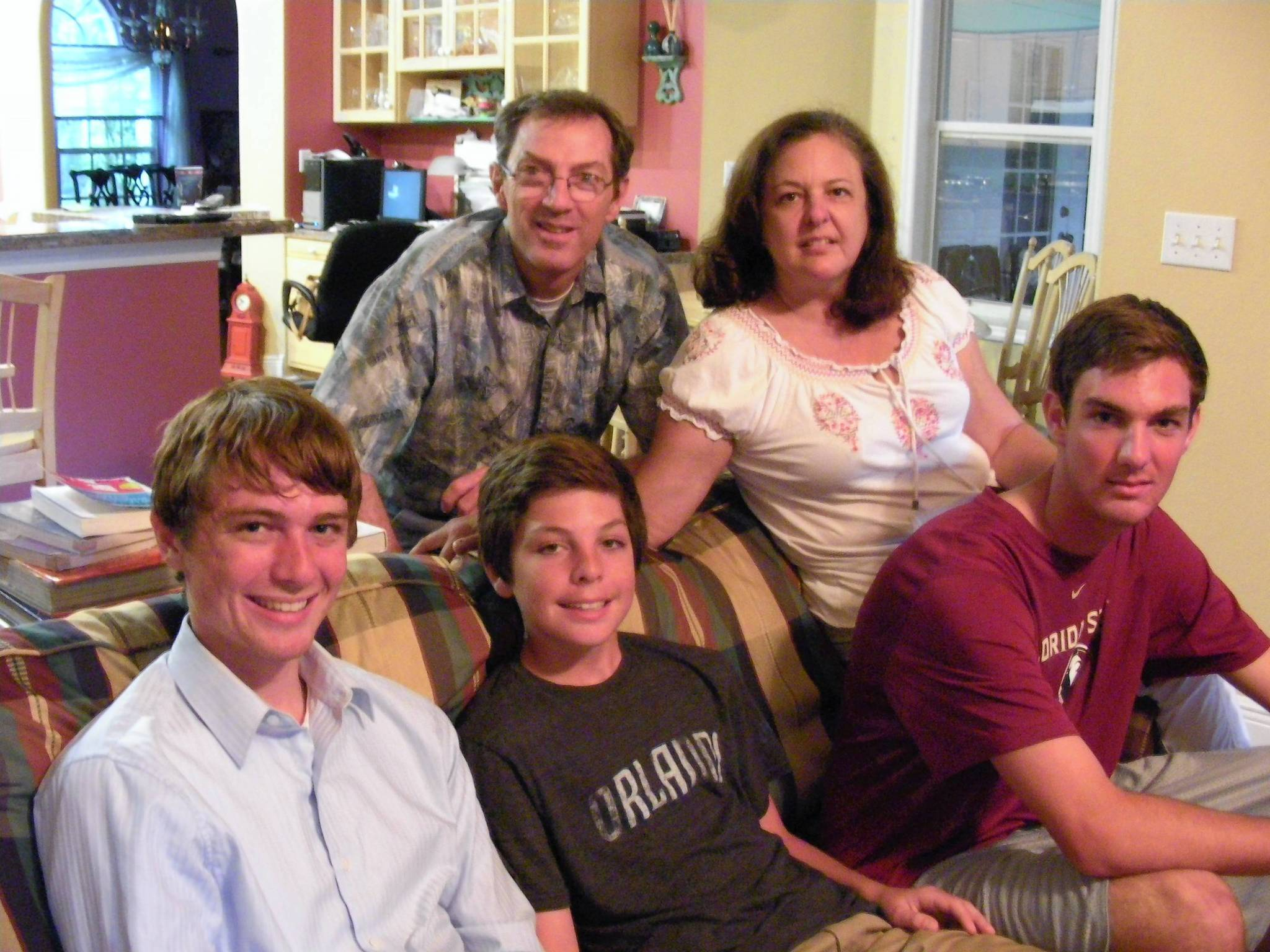 Bill and Susan Fay had hoped to get their children through college debt-free, but rising costs and state budget cuts have made that impossible. Shown here with them (left to right) are Dylan, a senior at University of Florida, Luke, a sophomore at Bishop Moore High School, and Max, a freshman at Florida State University.