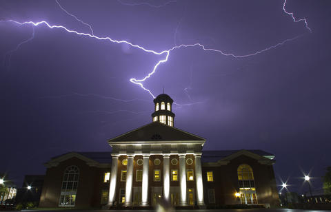 Lightening fills the sky over the Trible Library on the campus of Christopher Newport University Saturday evening as another night of threatening storms pass over the Peninsula.
