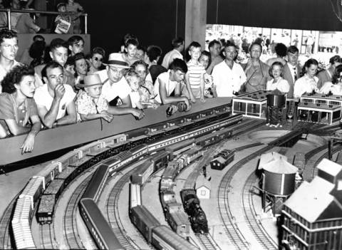 Crowd watching miniature trains in action at the Chicago Railroad Fair exhibit maintained by the eastern railroads, July 28, 1948. Several trains operate at the same time on this system.