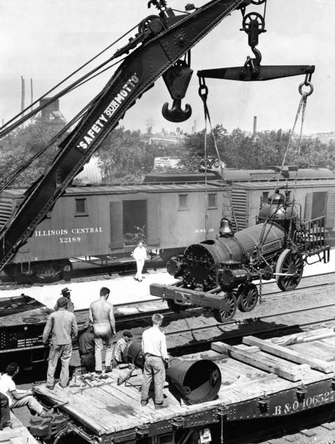 Baltimore and Ohio locomotive Lafayette build in 1837 is being unloaded for display at the Chicago Railroad Fair in 1948.