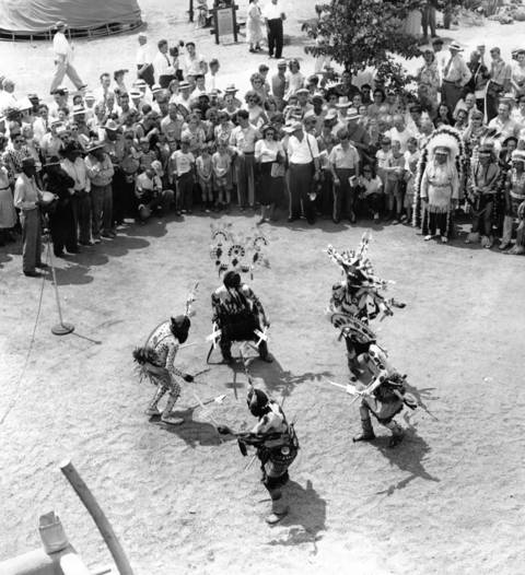 Hopi Indians doing the 'devil dance' for spectators at the Indian Exhibit presented by the Santa Fe railroad at the Railroad Fair, July 21, 1948.