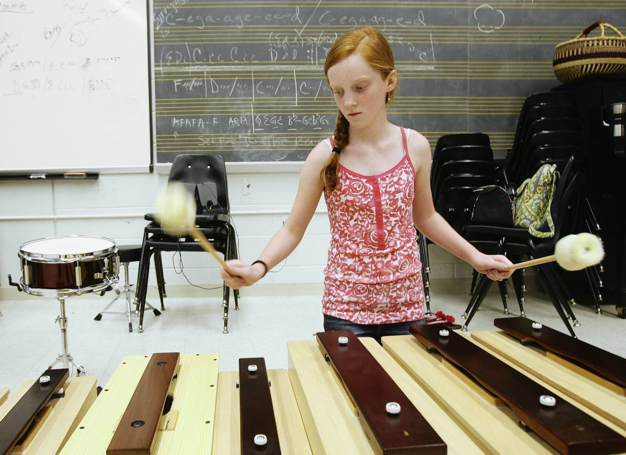 Natalie Gause , 11, plays the xylophone. Kids&#039; College students practice in World Drumming class at Lake Sumter Community College on Wednesday, June 27, 2012. (Tom Benitez/Orlando Sentinel)