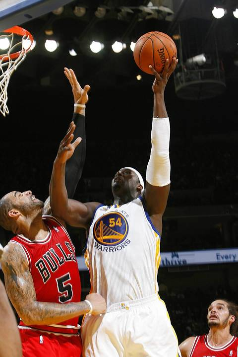 Golden State's Kwame Brown shoots the ball over Carlos Boozer.