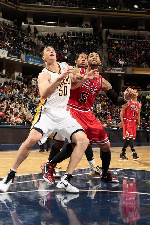 Pacers' Tyler Hansbrough boxes out Carlos Boozer during a preseason game.