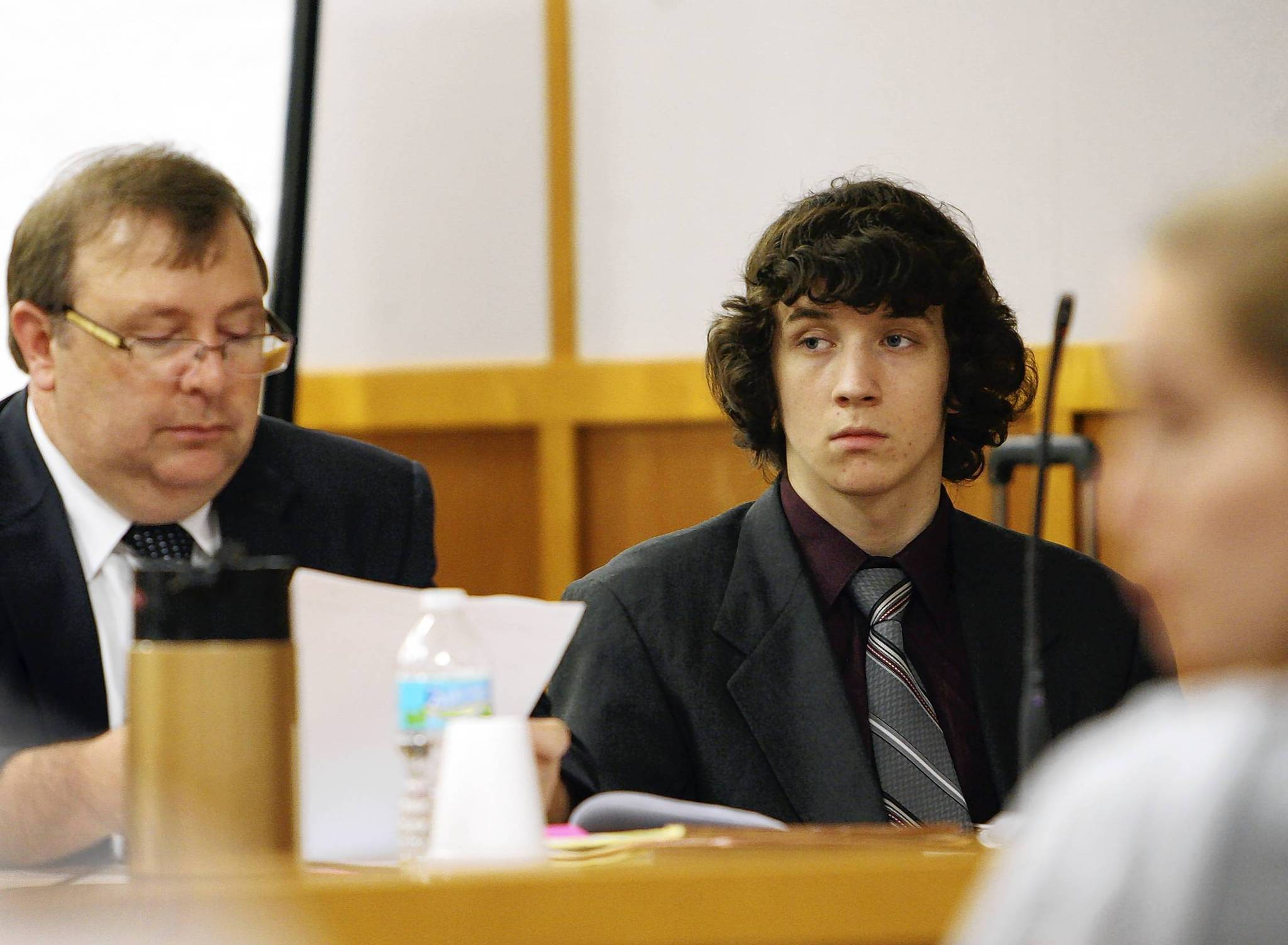 Ryan Ray, sitting next to his attorney James Hope, left, listens to attorneys as the question prospective jurors on Monday, during jury selectionRay is on trial for  first-degree murder. (Tom Benitez/Orlando Sentinel)