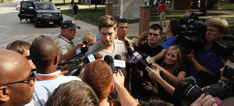 Jay Cutler answers questions after arriving at Chicago Bears training camp at Olivet Nazarene University in Bourbonnais.