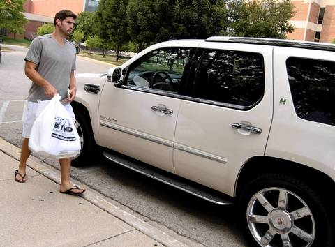 Jay Cutler returns to his vehicle to get personal items after arriving for Chicago Bears training camp at Olivet Nazarene University in Bourbonnais.