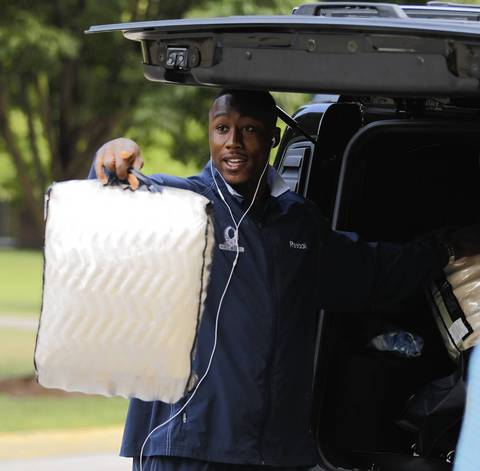 Brandon Marshall looks to find out where he needs to check in as he arrives at the Chicago Bears training camp at Olivet Nazarene University in Bourbonnais.