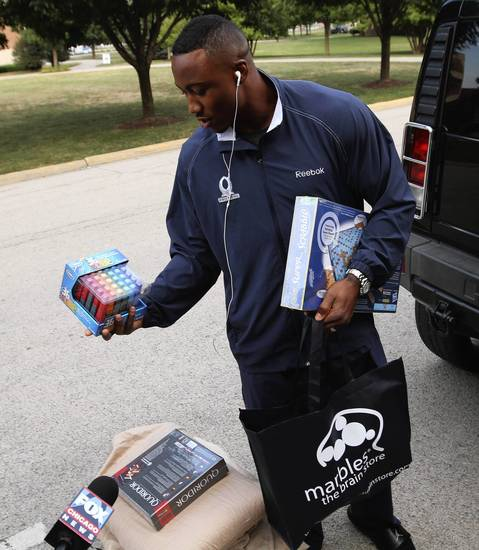 """Brandon Marshall arrives with """"brain teaser"""" games he bought on the way to Chicago Bears training camp at Olivet Nazarene University in Bourbonnais."""