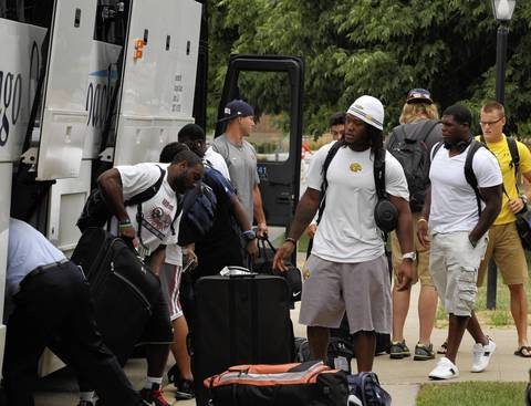 Young Chicago Bears hopefuls unload their luggage from the rookie bus as players arrave at Chicago Bears training camp at Olivet Nazarene University in Bourbonnais.