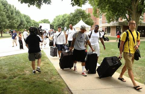 Rookie players arrive at Chicago Bears training camp at Olivet Nazarene University in Bourbonnais.