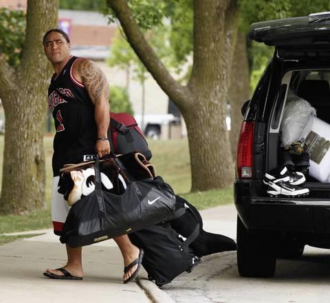 Matt Toeaina arrives as the Chicago Bears report to training camp at Olivet Nazarene University in Bourbonnais.