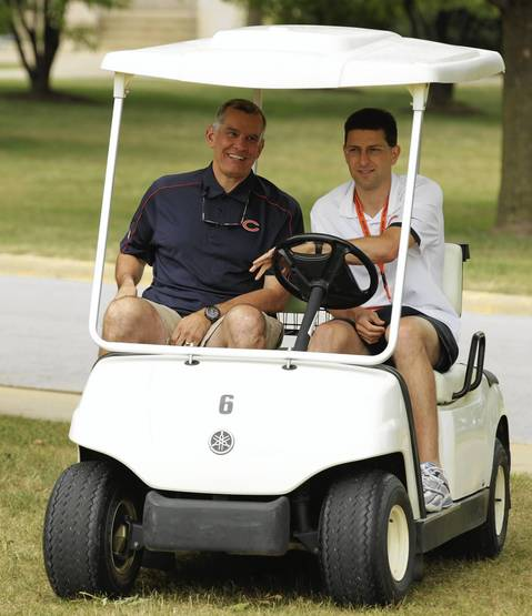 Chicago Bears General Manager Phil Emery (left) in camp is present as the Chicago Bears report to training camp at Olivet Nazarene University in Bourbonnais.