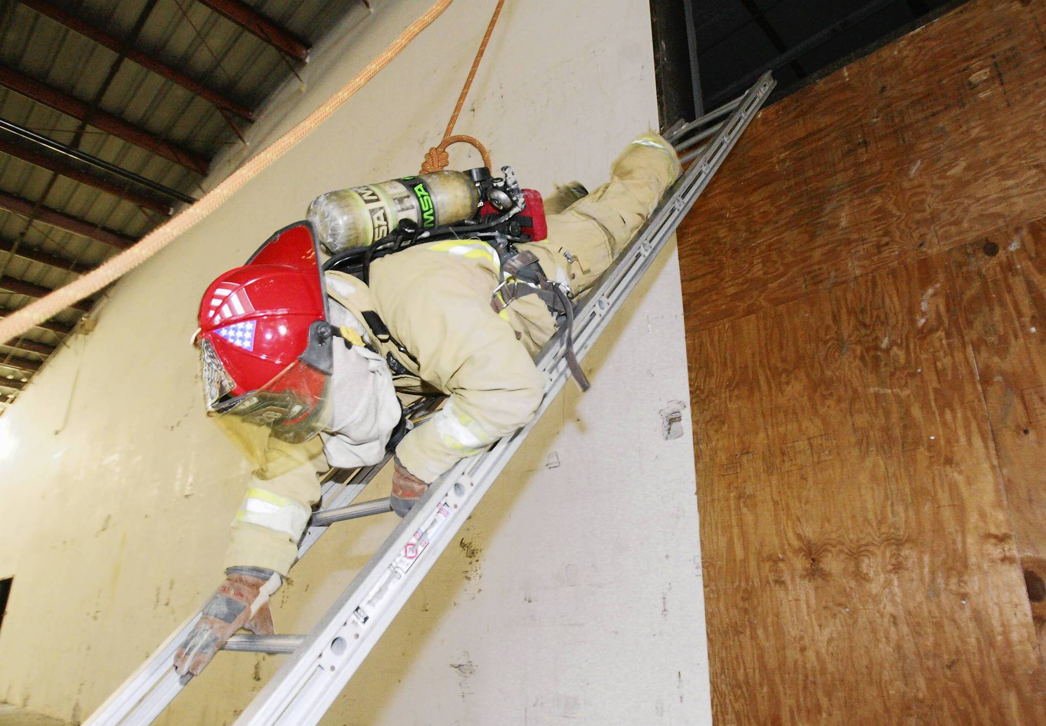 Firefighters train on Wednesday, July 18, 2012 .Firefighters from Eustis, Mount Dora, Tavares and Umatilla  took part in firefighter self-rescue training this week in the former Lowes home-improvement store on U.S.   441 in Eustis .(Tom Benitez/Orlando Sentinel)