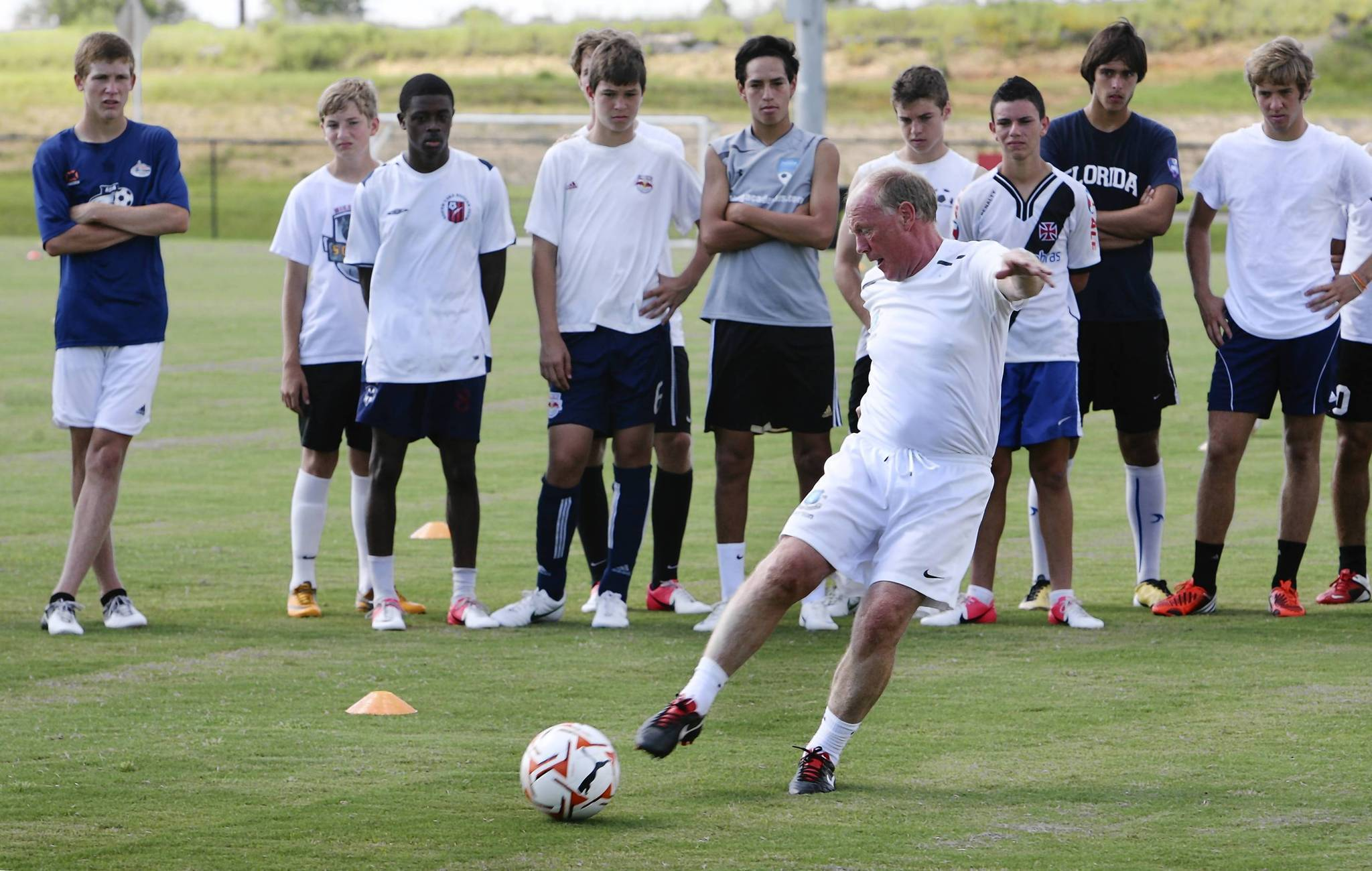 Ray Hall demonstrates technique on Wednesday, during the Caerus Soccer Academy camp at the National Training Center in Clermont. The camp is headed by  Hall, who has been instrumental in recruiting and developing some of the most gifted soccer players to emerge in Europe. (Tom Benitez/Orlando Sentinel)