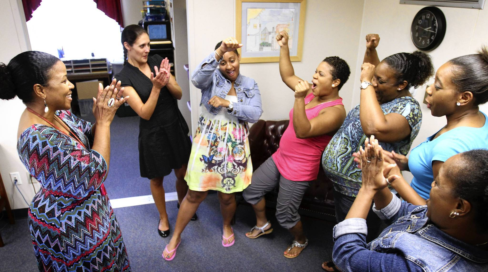 Principal Jennifer Porter-Smith (far left) celebrates with some teachers and staff Wednesday while talking about the school's dramatic turnaround. From left, Heather Maple; Kamilah McCallum; Stefanie Miller; Anna Kinchens; Kamari Smith; and Inez Mong.  (Joe Burbank, Orlando Sentinel)