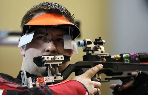 Peter Hellenbrand of The Netherlands competes in the 10m Air Rifle men final at the Royal Artillery Barracks in London
