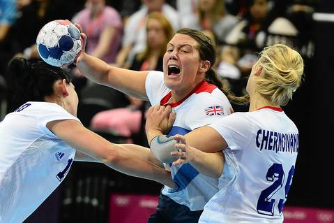 Britain's leftback Ewa Palies, left, vies with Russia's rightwing Olga Chernoivanenko during the women's preliminaries Group A handball match of Great Britain vs. Russia at the Copper Box hall in London.