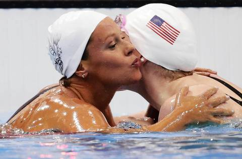 Italy's Federica Pellegrini, left, kisses Missy Franklin of the U.S. after finishing first in heat 3 of the women's 200m freestyle heats during the London 2012 Olympic Games at the Aquatics Centre. Franklin came in second.