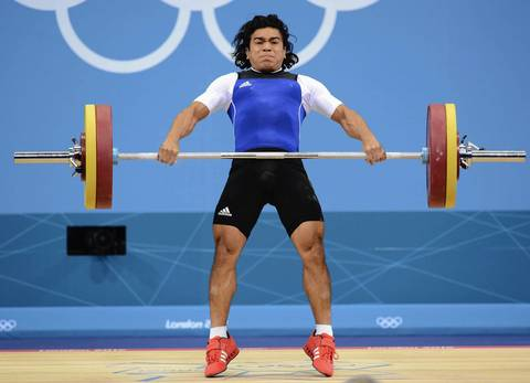 Julio Cesar Salamanca Pineda (ESA) snatch lifts 110 kg in the Men's 62kg weightlifting during the 2012 London Olympic Games at ExCeL - South Arena 3.